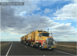 Truck Driving down the road - Fleet Management, Vehicle Tracking and Telemetry